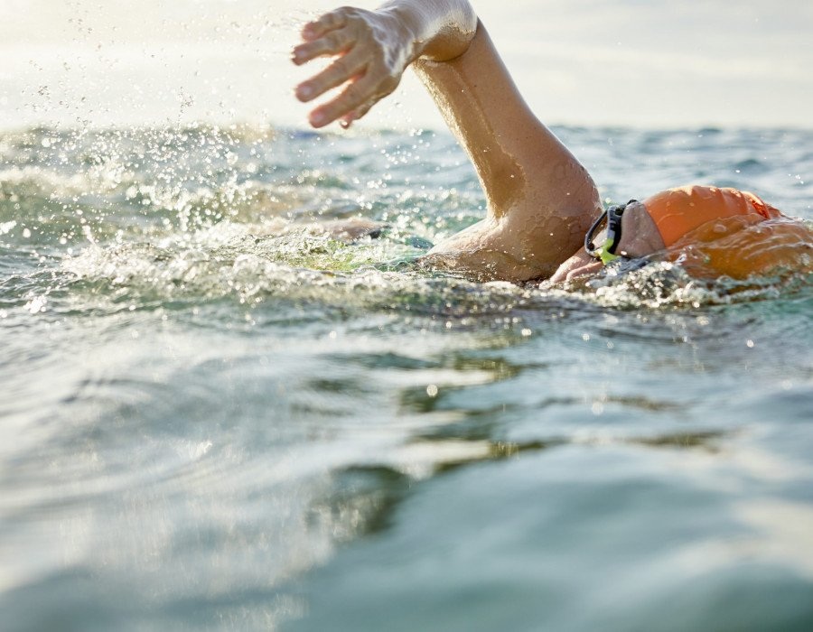 How can I prevent injury when I return to swimming?